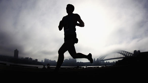 Researchers say our brains are probably wired from an evolutionary sense to encourage running and high aerobic activities. Above, a man runs past the Sydney Harbour Bridge on April 22.