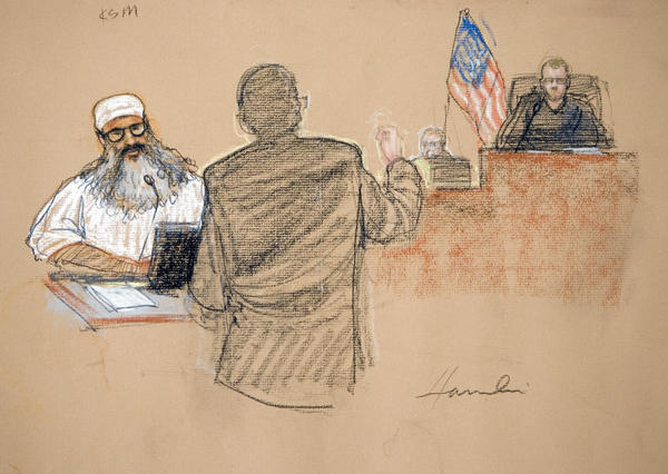 In this photograph of a courtroom sketch, Khalid Sheikh Mohammed, charged with orchestrating the Sept. 11 attacks, attends a court hearing at Guantanamo in 2008. He's expected to appear in a military court Saturday.