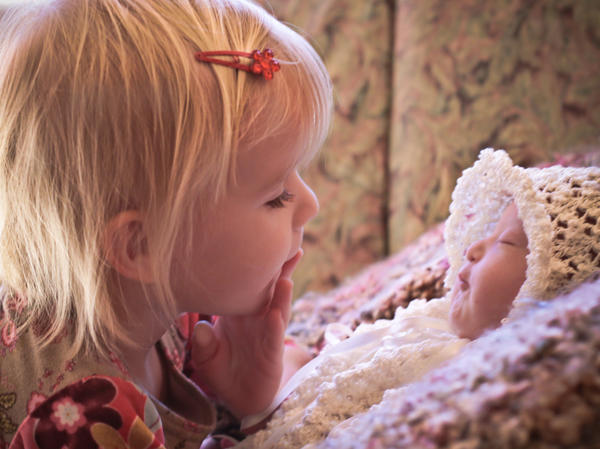 Kelle Hampton's daughter, Lainey, loved her little sister, Nella, before she even met her.