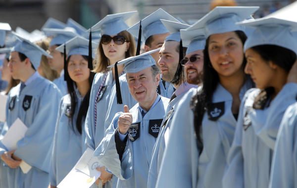 Columbia University janitor Gac Filipaj give a thumbs up during the Columbia University School of General Studies graduation ceremony on Sunday.