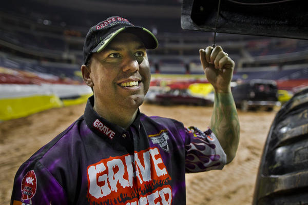 "Rod Schmidt, the current driver of the Grave Digger #18 truck, has been driving for the team for more than a decade and says it's ""the greatest job ever."""