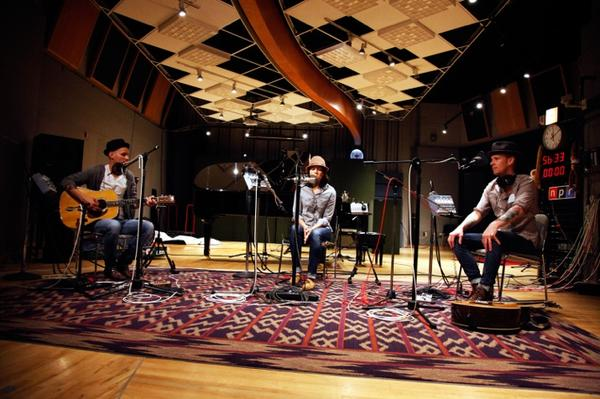 Brandi Carlile performs in NPR's Studio 4A, backed by brothers Tim (left) and Phil Hanseroth.