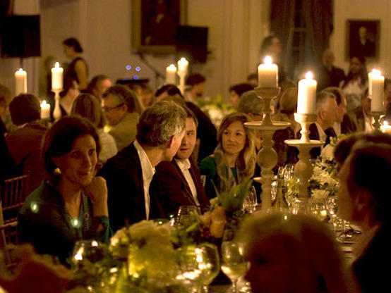 By paying to join the <em>Garden & Gun</em> club, members can attend events like a candlelight affair at the historic South Carolina Society Hall in Charleston as part of <em>Garden & Gun's</em> Secret Society Supper Club.