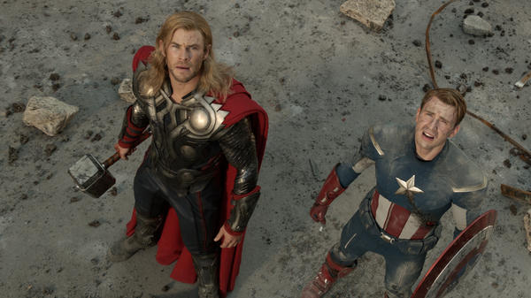 Chris Hemsworth and Chris Evans as Thor and Captain America in <em>The Avengers</em>.