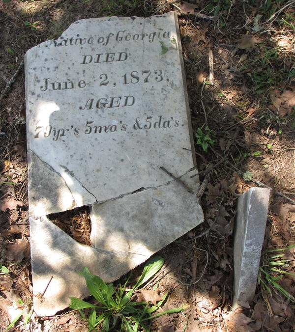 The headstone for Benjamin Taylor, who died in 1873. Taylor helped drive a wagon train for pioneers who settled in Northern California's Green Valley in 1850. His headstone has  been pieced together after being found under a foot of dirt. Caretaker Tony Pires says he hopes to find the missing piece.