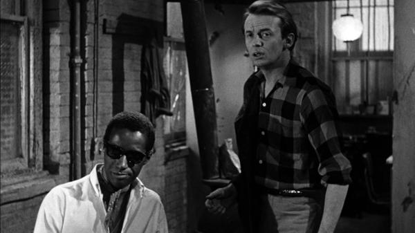 In <em>The Connection</em>, Leach (Warren Finnerty, right) and his friends wait around for their heroin fix, which eventually comes courtesy of Cowboy (Carl Lee). The controversial film was shut down in New York after two screenings in 1962.
