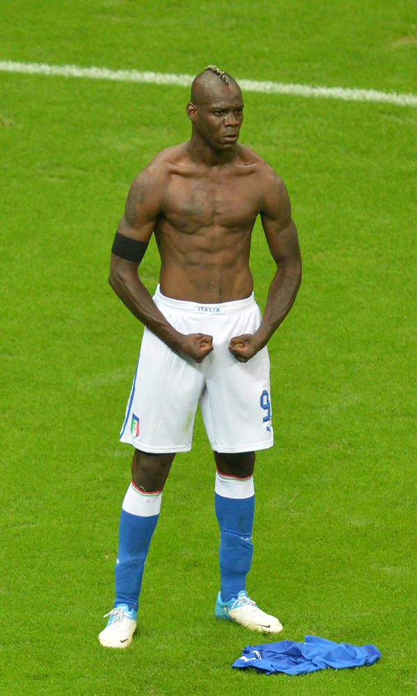 Italian forward Mario Balotelli celebrates after scoring the second goal during Italy's semifinal matchup with Germany in the Euro 2012 soccer championships in Warsaw, June 28. Italy went on to lose in the finals to Spain, but Balotelli has been hailed as a national hero, spurring debate over what constitutes Italian-ness.