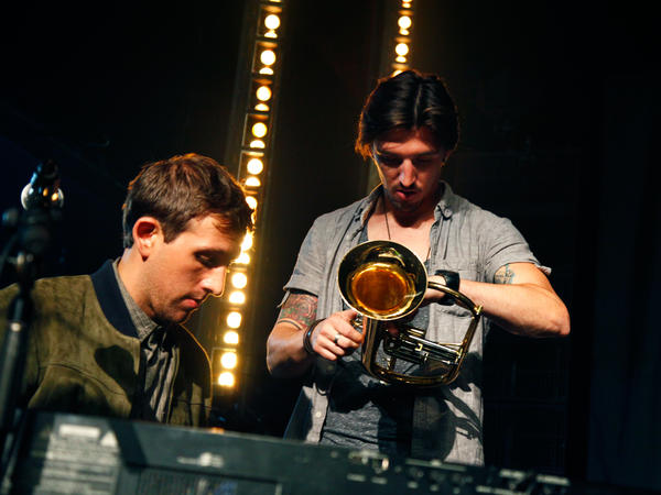 Guitar tech Shane Timm (right) and fun.'s keyboard player Andrew Dost on stage in Brooklyn.
