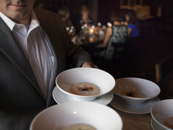 A server at Ardeo+Bardeo shows off potato mousse with a coddled egg hidden inside.