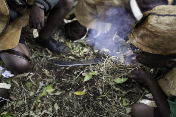 Equipped with two sticks, tinder and a lot of patience, the Batwa make small clumps of smoldering grass to ward off bees and harvest fresh honeycombs. Honey is so valuable that they use it as a bride price.