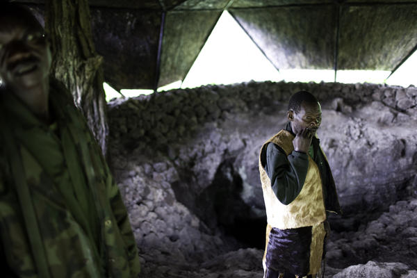 Besides finding safety in the forests, the Batwa also took shelter in a local cave they called Garama. The cave is a low-ceilinged lava tube beneath the mountain where the chief used to hold his councils, and where women and children hid during battle.