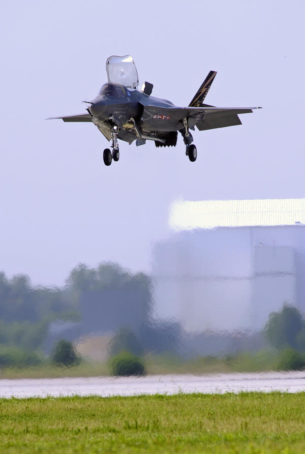 A Marine Corp F-35B Joint Strike Fighter lands at Patuxent Naval Air Station in Maryland in 2011. Analysts say that if mandatory Pentagon budget cuts are imposed next year, fewer new planes could ultimately be ordered.