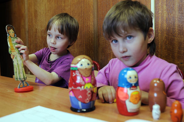 Children play in an orphanage in Moscow. While some Russian officials are critical of foreign adoptions, the U.S. and Russia are finalizing an agreement designed to improve the safety and quality of adoptions of Russian children by American families.