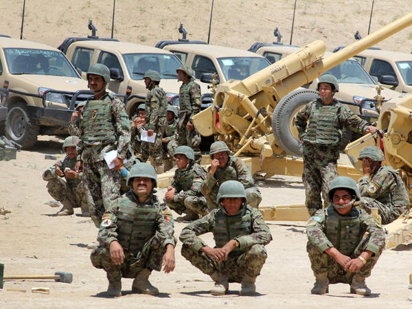 Afghan soldiers conduct an artillery training exercise in the northwest province of Badghis in July 2012.