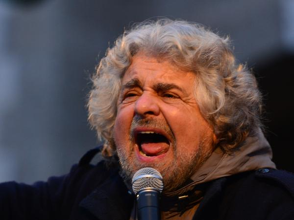 Comedian-turned-politician Beppe Grillo addresses supporters at a rally on Feb. 12 in Bergamo, Italy. Many pollsters say his populist Five Star Movement could come in third in this weekend's election.