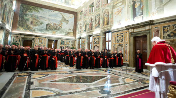 "In this photo provided by the Vatican newspaper <em>L'Osservatore Romano</em>, Pope Benedict XVI delivers his message during his farewell meeting to cardinals Thursday. Benedict promised his ""unconditional reverence and obedience"" to his successor."
