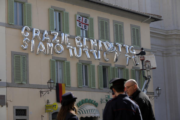 "Inflatable letters compose a message in Italian reading ""Thank you, Benedict, we are all with you"" Thursday in Castel Gandolfo, the scenic town south of Rome where Benedict will spend his first post-Vatican days and make his last public blessing as pope."