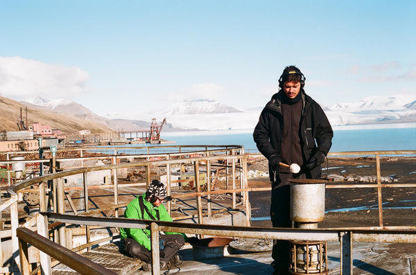 """<strong>""""It almost sounds like a vibraphone."""" </strong>Mads Brauer (left) and Rasmus Stolberg record sounds atop one of the empty fuel tanks that Brauer would manipulate into the organlike sounds on the song """"Sedna."""""""