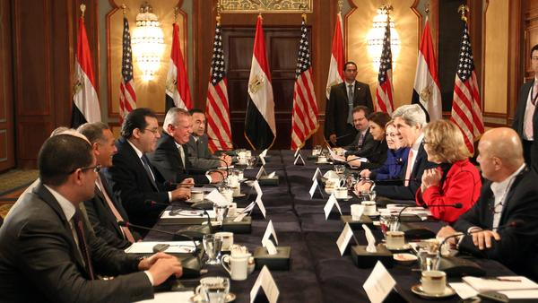 Secretary of State John Kerry (center, right) meets with members of Egyptian political parties in Cairo on Saturday.