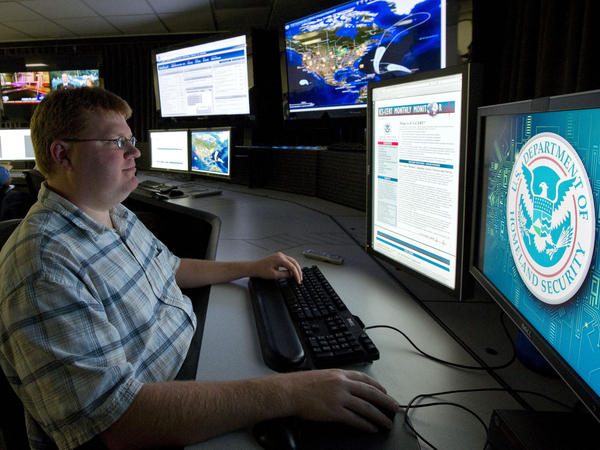 An analyst works at a federal cybersecurity center in Idaho in 2011. Experts say Internet-connected infrastructure is a possible target of cyberwarfare.