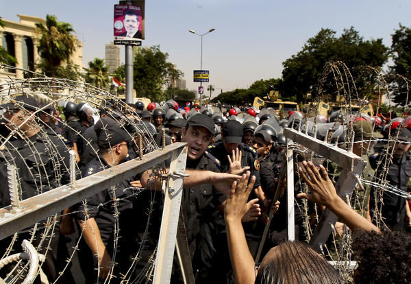 An Egyptian military police officer argues with protesters during a demonstration on June 14, 2012, outside the Supreme Constitutional Court in Cairo.
