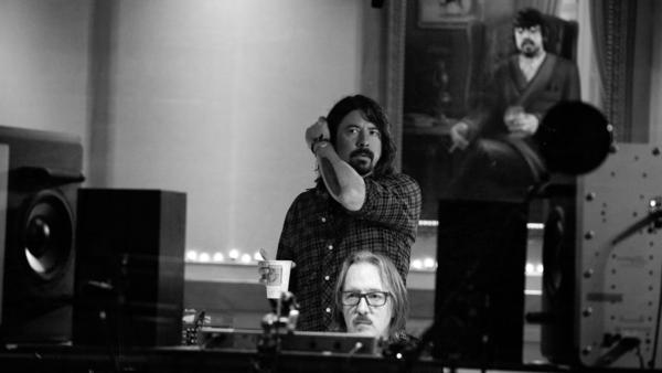 Dave Grohl reunited with his old friend Butch Vig (at console), the producer of Nirvana's <em>Nevermind</em>, for the making of <em>Sound City: Real to Reel</em><em>.</em>