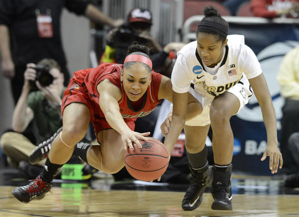 Louisville's Bria Smith, left, battles Purdue's April Wilson for a loose ball during their second-round game in Louisville, Ky., Tuesday.