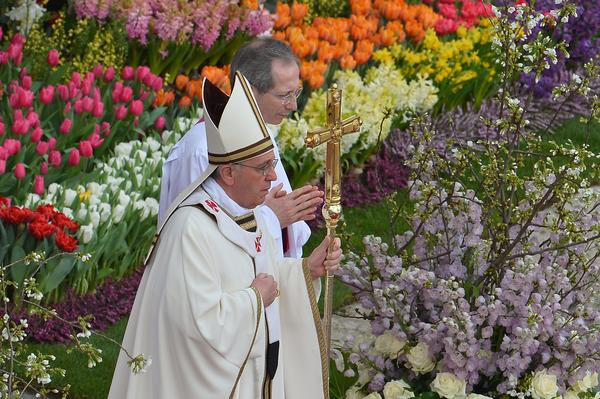 """The sun competed with clouds in the sky, but the square was a riot of floral color in Rome, where chilly winter has postponed the blossoming of many flowers. The pope advised people to let love transform their lives, or as he put it, """"let those desert places in our hearts bloom."""""""