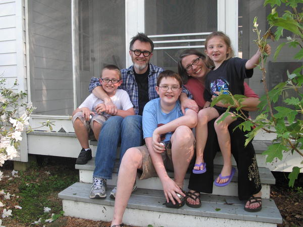 The Drehers — Lucas (from left), Rod, Matthew, Julie and Nora — sit on the side stoop at their new home in St. Francisville, La.