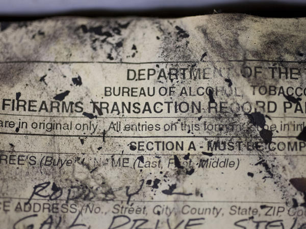 The Bureau of Alcohol, Tobacco, Firearms and Explosives (ATF) processes firearm transaction documents from firearms dealers no longer in business, no matter the condition of the documents, such as this fire-and-water damaged ledger at their National Tracing Center in Martinsburg, W.Va.