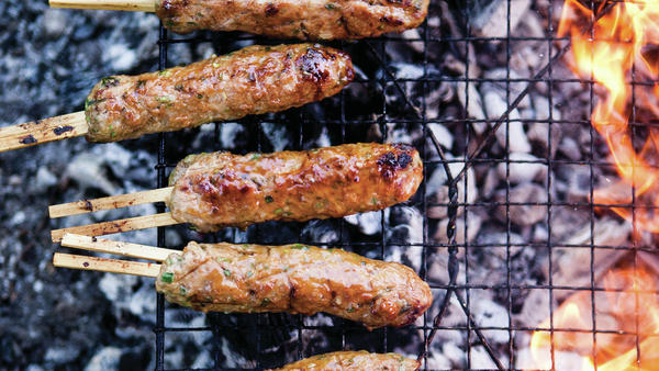 <em>Bon Appetit</em> editor Adam Rapoport compiled recipes from all over the world for <em>The Grilling Book</em>. Pictured here are Chicken Yakitori.