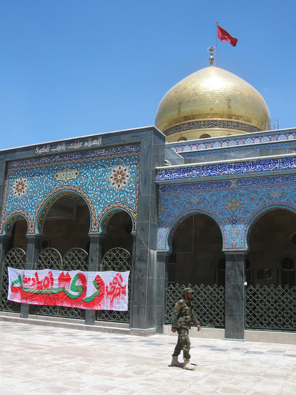 A Syrian soldier walks past the shrine, which is guarded by forces loyal to President Bashar Assad.