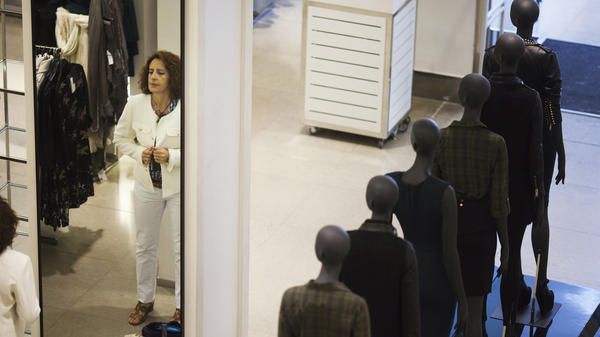 A woman tries on a jacket at a Zara store in Madrid. Zara's parent company, Inditex, was among Spanish companies to sign fire and building safety agreements for their factories in Bangladesh following a deadly factory collapse in April, though Inditex was not directly involved in that incident.
