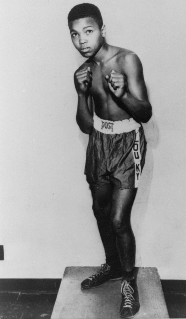 An 85-pound Cassius Marcellus Clay Jr. is shown posing at 12 years old, prior to his amateur ring debut in 1954. He won a gold medal in the light-heavyweight division at the 1960 Summer Olympic Games in Rome as a member of the U.S. Olympic boxing team.