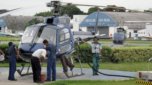 A helicopter is refueled at an airfield in Sao Paulo in 2009. The wealthy rely on helicopters in Brazil to avoid the gridlocked traffic. Politicians who frequently use helicopters, even for short commutes, are now coming under criticism.