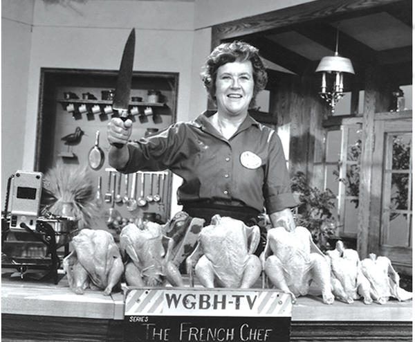 "Julia Child poses with ""the chicken sisters"" before an episode of <em>The French Chef</em> in which she teaches us how to roast a bird."