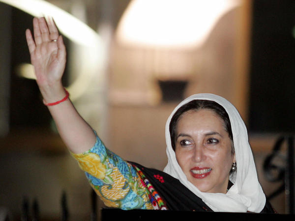 Benazir Bhutto, who served two terms as Pakistan's prime minister, waves to supporters at the Islamabad International airport on Nov. 6, 2007. She was killed in a bombing attack the following month.
