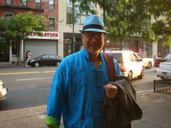 Fred Ho is known for the bright clothing he wears, which he makes himself.