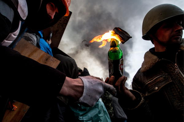 Anti-government protesters throw Molotov cocktails in Kiev's Independence Square during clashes with police. Streets and squares in Ukraine's capital are littered with rocks, bricks, spent stun grenades and tear gas canisters, rubber bullets and burning tires, the BBC's David Stern said on <em>Morning Edition</em>.