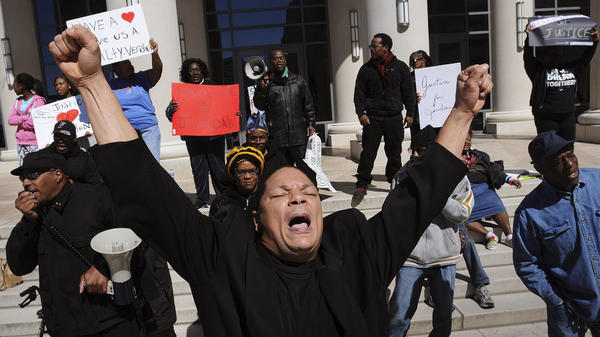 Bobby Worthy, President of The Justice League, leads a chant outside of the Duval County Courthouse during the trial of Michael Dunn in Jacksonville, Fla., on Saturday.