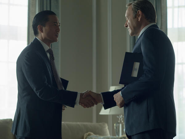 Chinese billionaire Xander Feng, played by Terry Chen, shakes hands with Francis Underwood, played by Kevin Spacey, in Netflix's <em>House of Cards</em>.