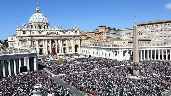 People gather as Pope Francis holds Easter Mass in St. Peter's Square on Sunday. The Vatican spokesman estimated the crowd to be about 150,000 people. Much larger crowds are expected this Sunday.