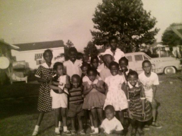 Children in the Truxton neighborhood of Portsmouth, Va., where professor Brenda Stevenson grew up, pose for a photo.