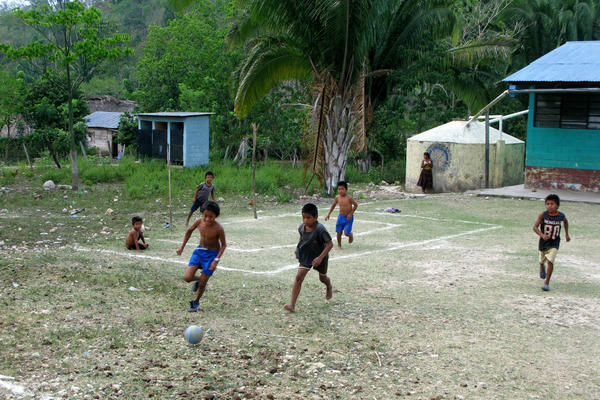 Football on a makeshift field in Limon, Guatemala.