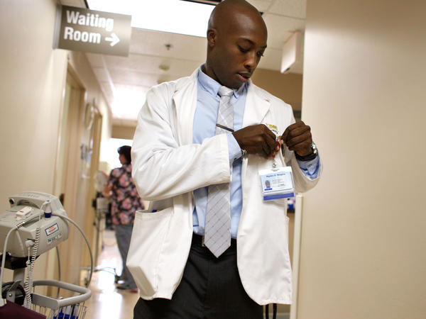First-year medical student Ngabo Nzigira gets ready to see a patient at a Kaiser Permanente facility in Sacramento.