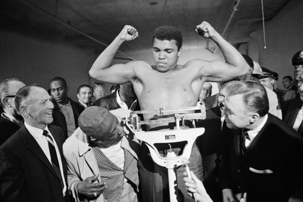 Boxer Muhammad Ali weighs in a week before his heavyweight bout with Jerry Quarry on Oct. 20, 1970 in Atlanta. Ali died at 74.