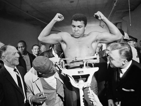 Boxer Muhammad Ali weighs in before his heavyweight bout with Jerry Quarry on Oct. 20, 1970, in Atlanta.