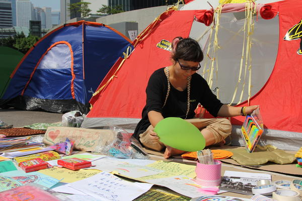 Map Tang, a social worker, has set up an art therapy center at her tent. She says protesters are exhausted after three weeks of demonstrations and need a way to express their feelings.