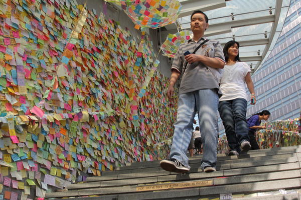 "This is Hong Kong's ""Lennon Wall,"" where protesters and supporters have put up thousands of post-it notes expressing their desires for democracy and support for the city. It's based on a similar wall in Prague."