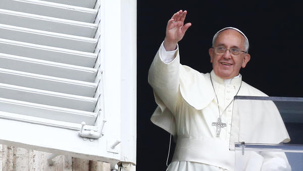 Pope Francis waves in Saint Peter's square at the Vatican. The pope heads to Turkey on Friday, a country with few Catholics, but he plans to reach out to Muslims and to the Orthodox Church.
